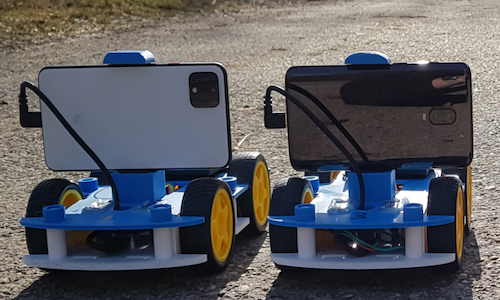Photo of two smartphone-powered robots.